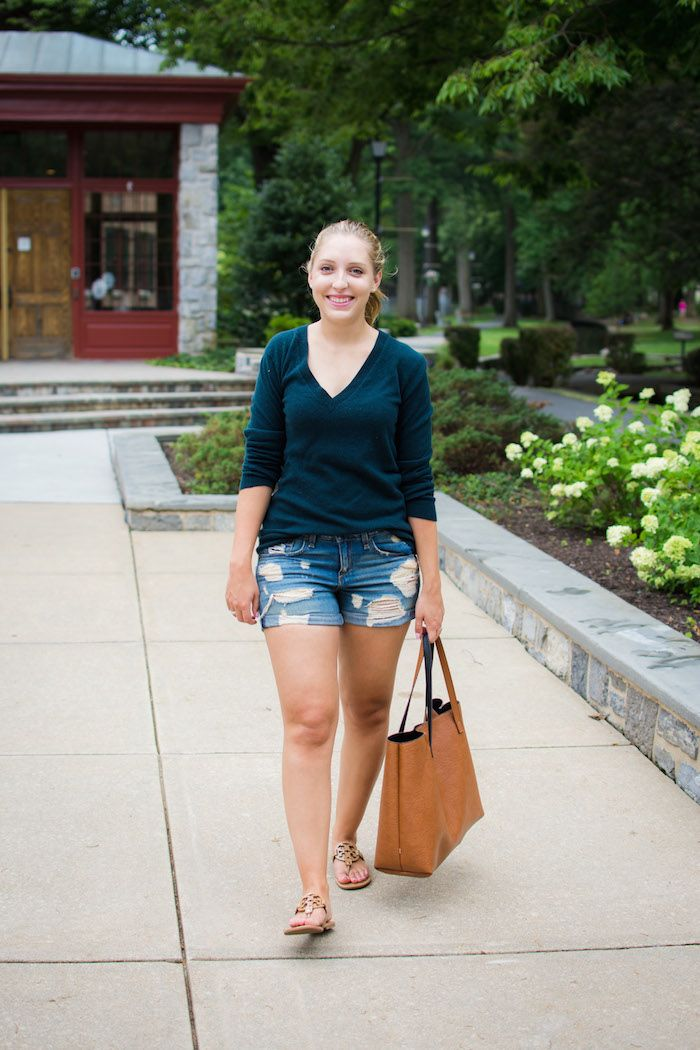 An easy way to transition from summer to fall? Pair your favorite distressed denim shorts with a cashmere sweater.
