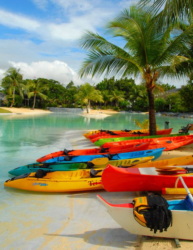 Colorful kayaks in Plantation Bay, Cebu, Philippines The