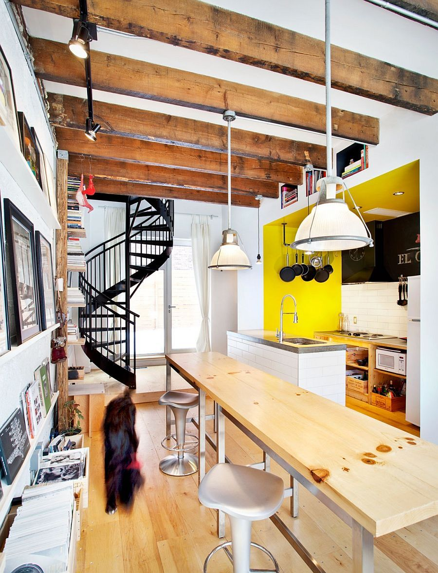 Exposed ceiling beams spiral staircase and decor give the interior an industrial touch