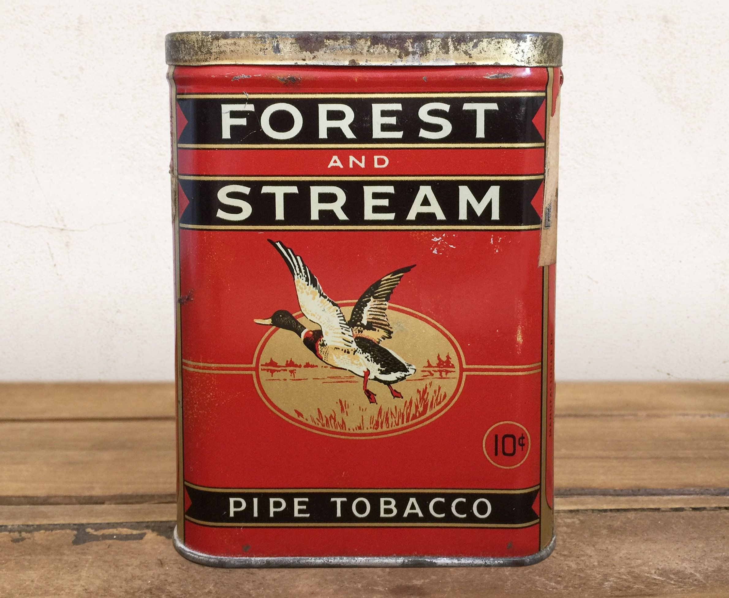 Vintage Tobacco Tin Forest And Stream Pocket Tobacco Can Etsy In 2020 Rustic Shelves Decor Tin Antiques