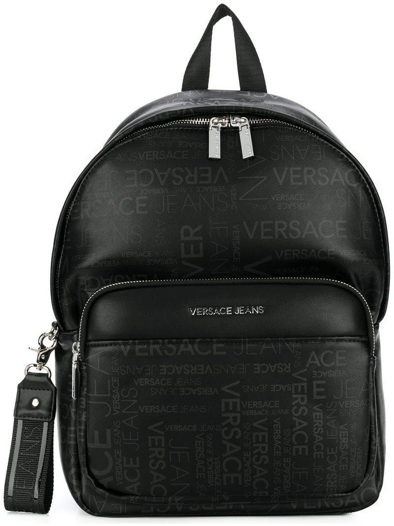 c15decb920af VERSACE JEANS LOGO PRINT BACKPACK.  versacejeans  bags  denim  backpacks
