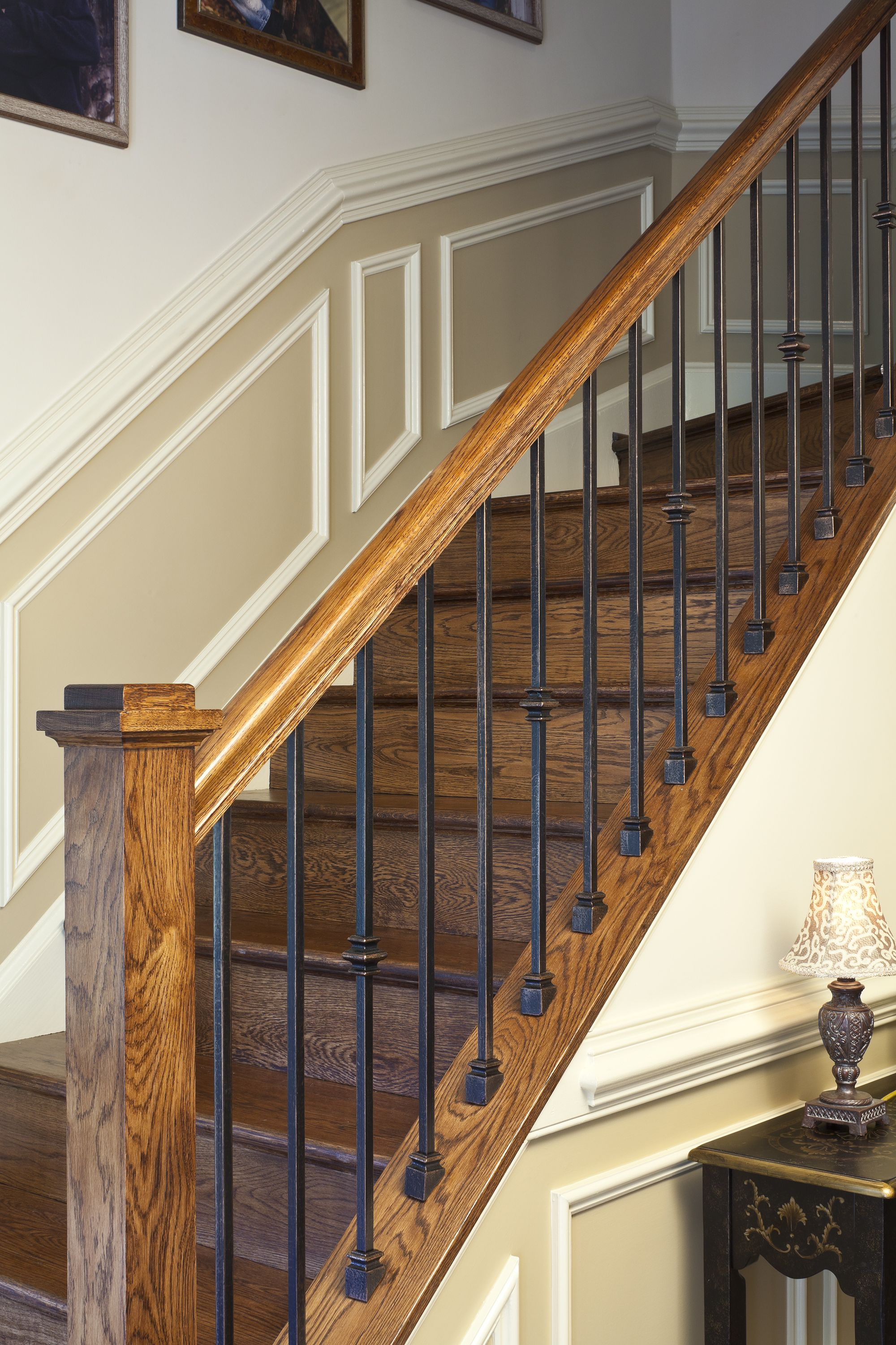 Custom fabricated wrought iron spindles with stained rail ...