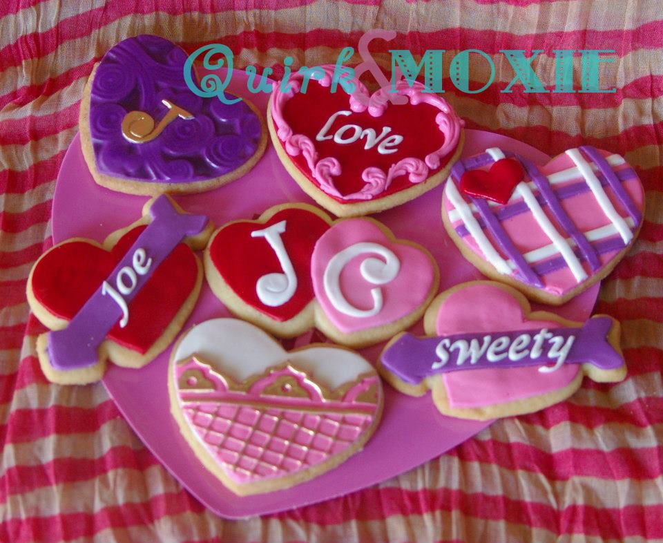 Buttery sweet cookies cover in flavored fondant for Valentine's Day! Facebook.com/quirkmoxie