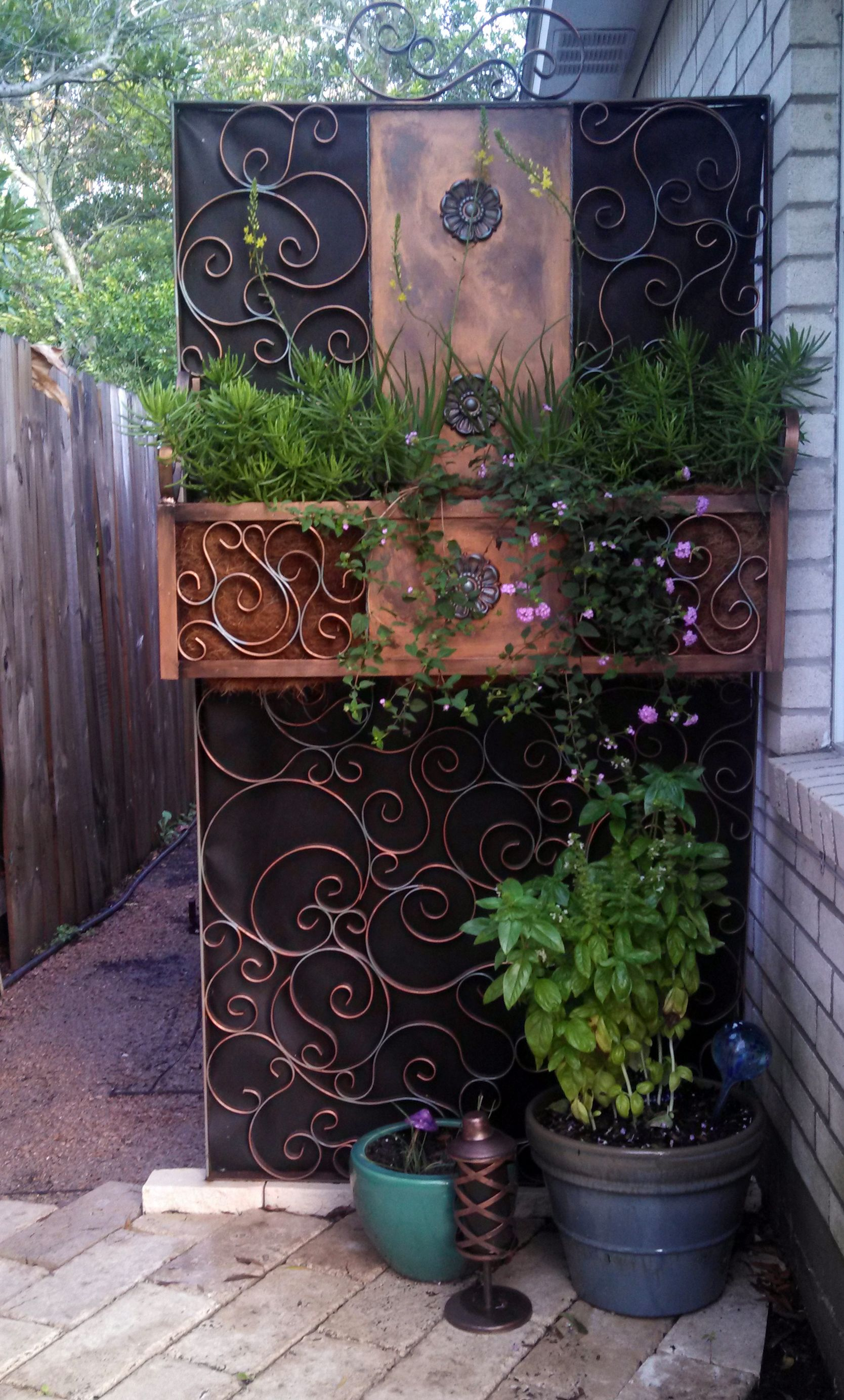 I created this trellislike planter to block the view of