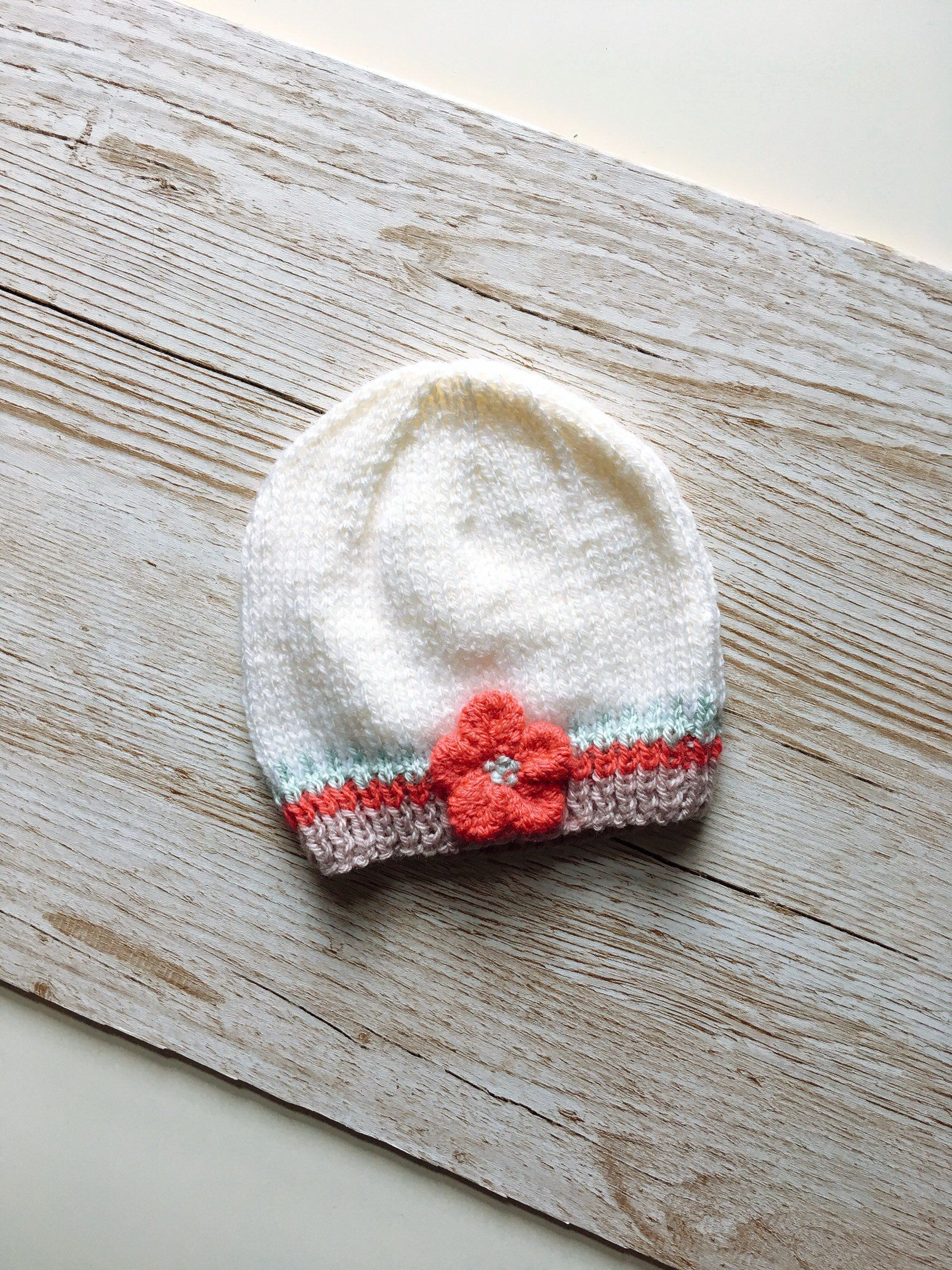 A  Raspberry pink Hand Knitted Toddlers Beanie hat in DK yarn