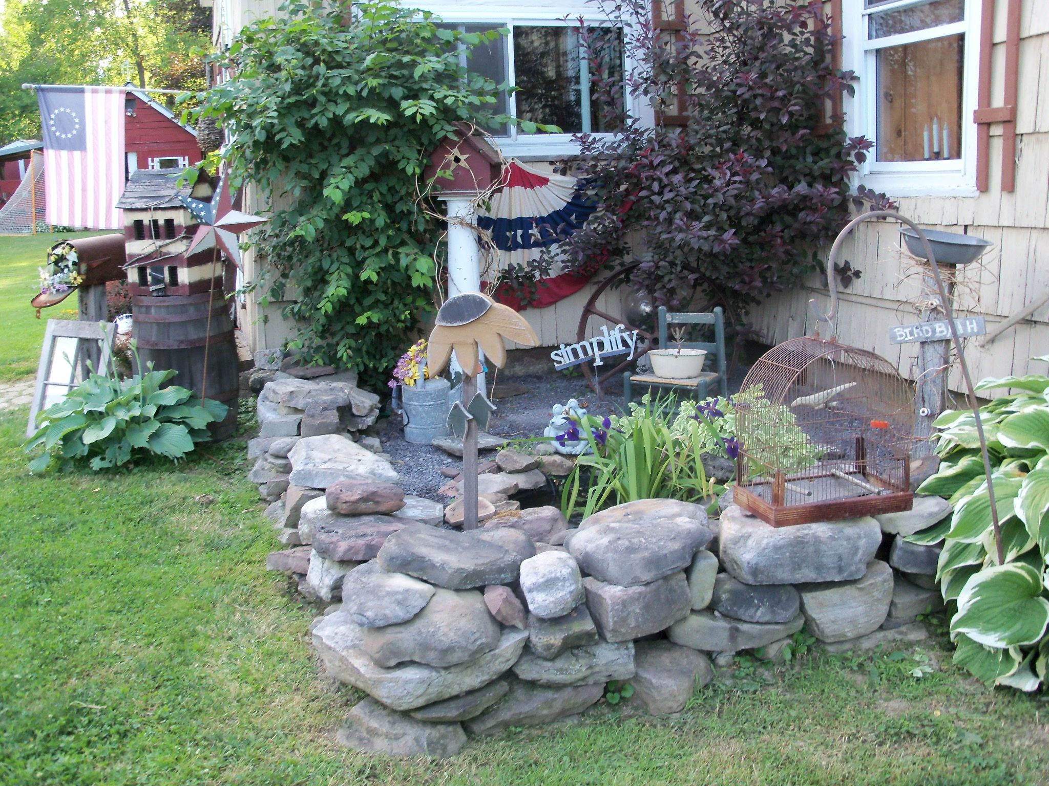 Another shot of my stone wall and yet another mini fish pond ...