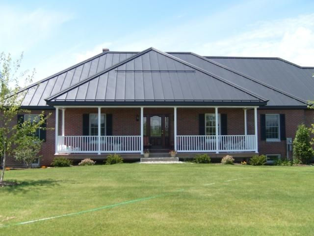 Dark grey painted roof with red brick flip or flop for Metal roof pictures brick house