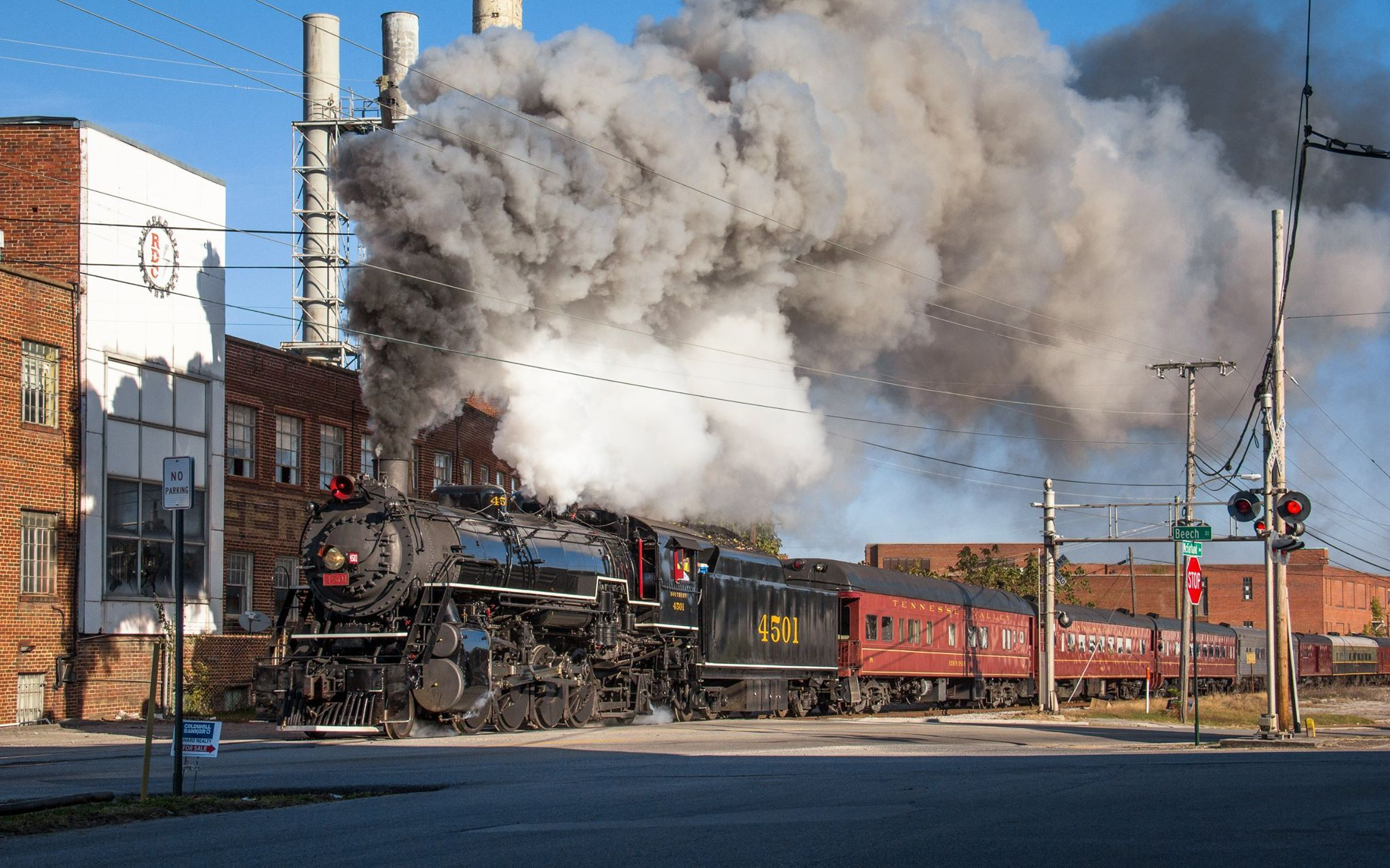Recently restored Southern Railway Mikado #4501 hauls the Tennessee Valley Railroad Museum's Summerville Steam Special excursion through the northwest Georgia border town of Rossville on a cool October morning. Behind the train is an old Peerless Woolen Mills site which out-dates the '01 by six years. Rossville, Georgia; 10/25/2014