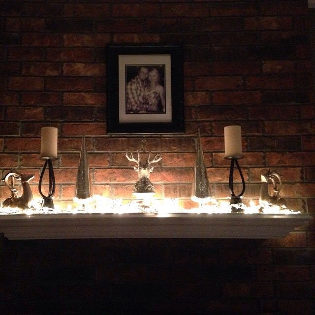 Painted the mantle white, lights and added some decorations from Hobby Lobby! ALL white, silver and gold. LOVE