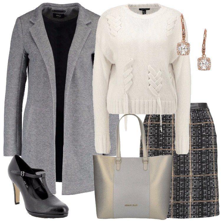 Un outfit everyday, composto da gonna corta a campana grigio