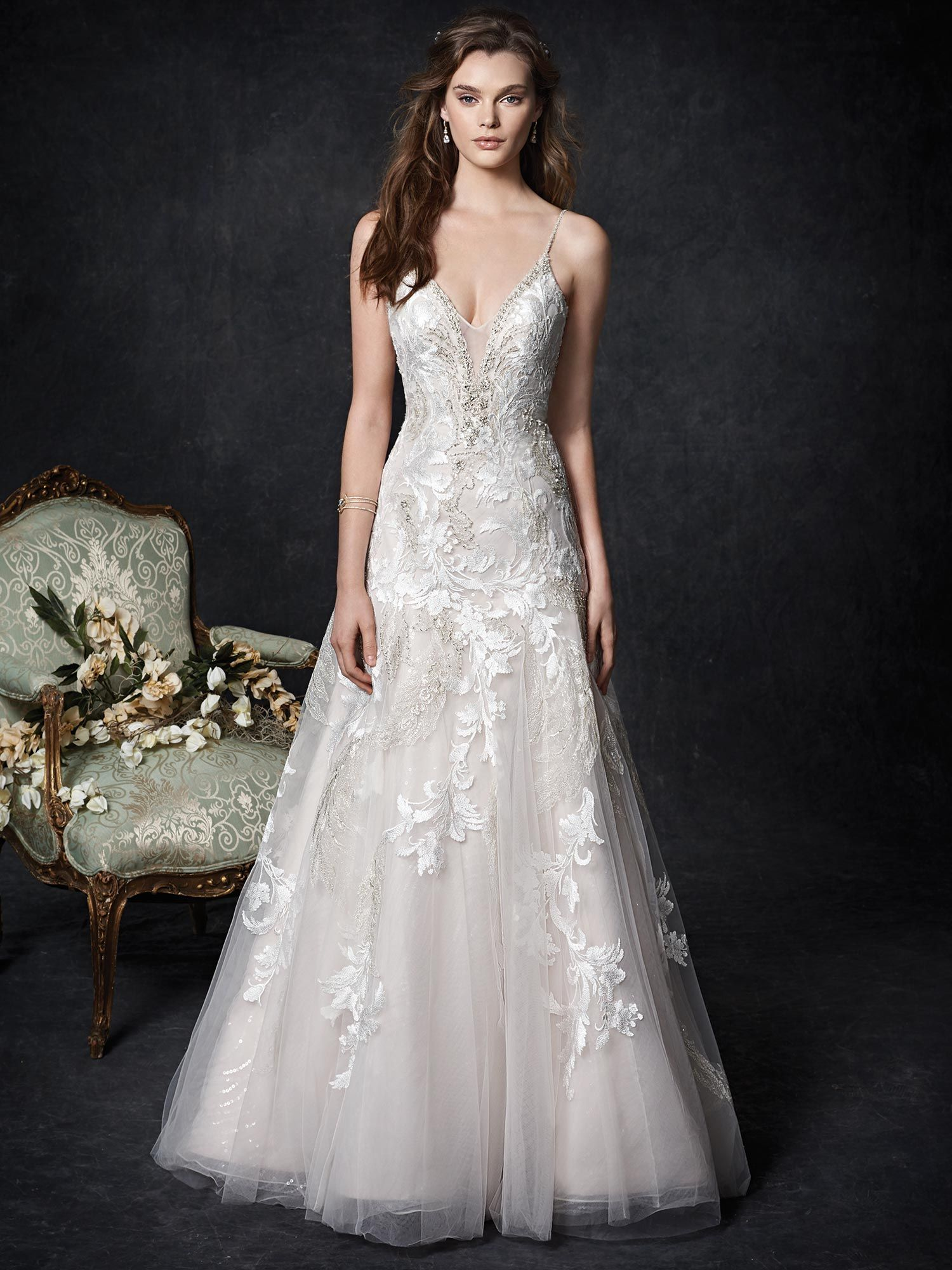 685c164e4 Kenneth Winston  1758 - Modified A-line wedding gown with scattered metallic  lace appliques and a plunging illusion neckline. The beaded spaghetti  straps ...