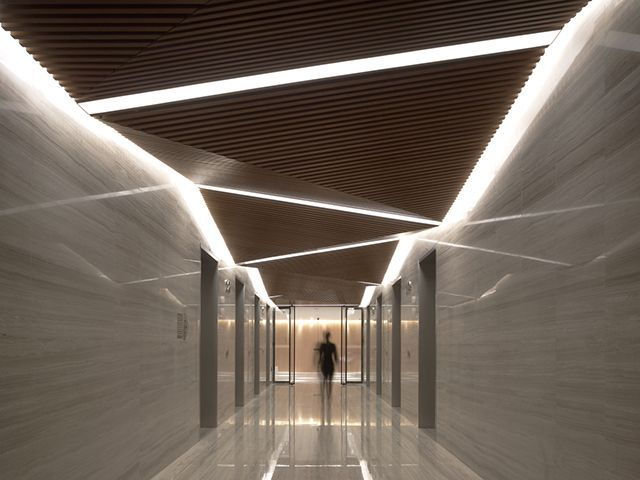 Unique lighting design for a contemporary lobby design for Modern office ceiling design ideas