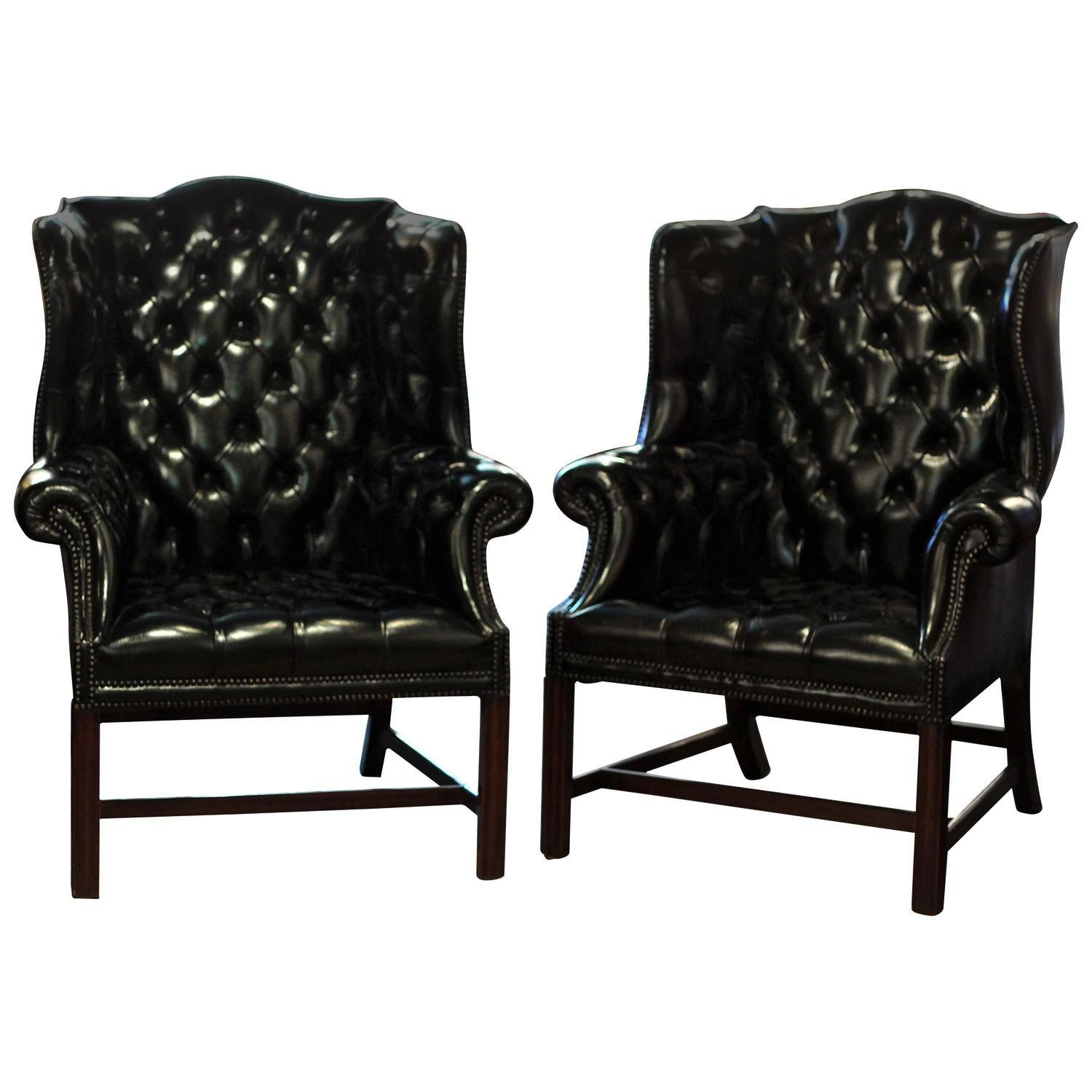 Black black tuffed buttoned wing back chairs leather