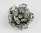 April Showers bring May Flowers: An Etsy treasury by charmings that features our Silver Flower Brooch!  Double click through to see the entire treasury!