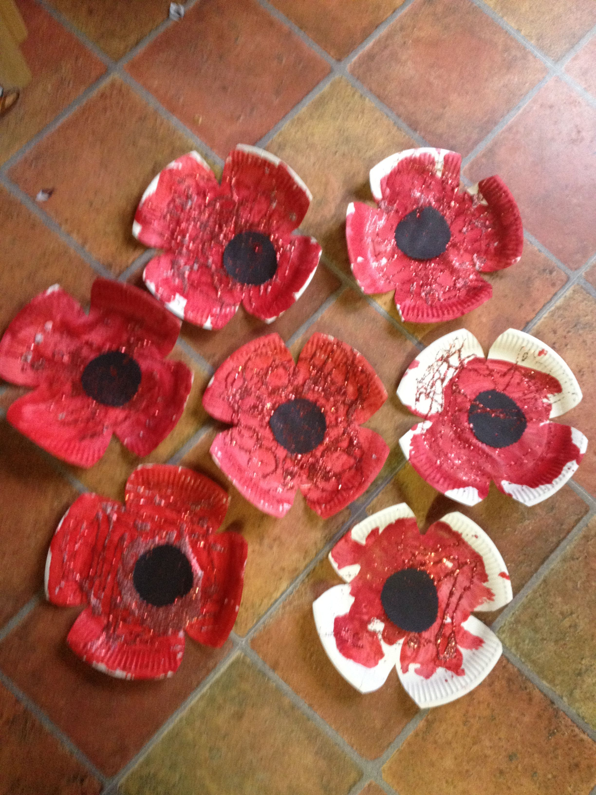 Paper plate poppies remembrance. Have the kids paint the ...