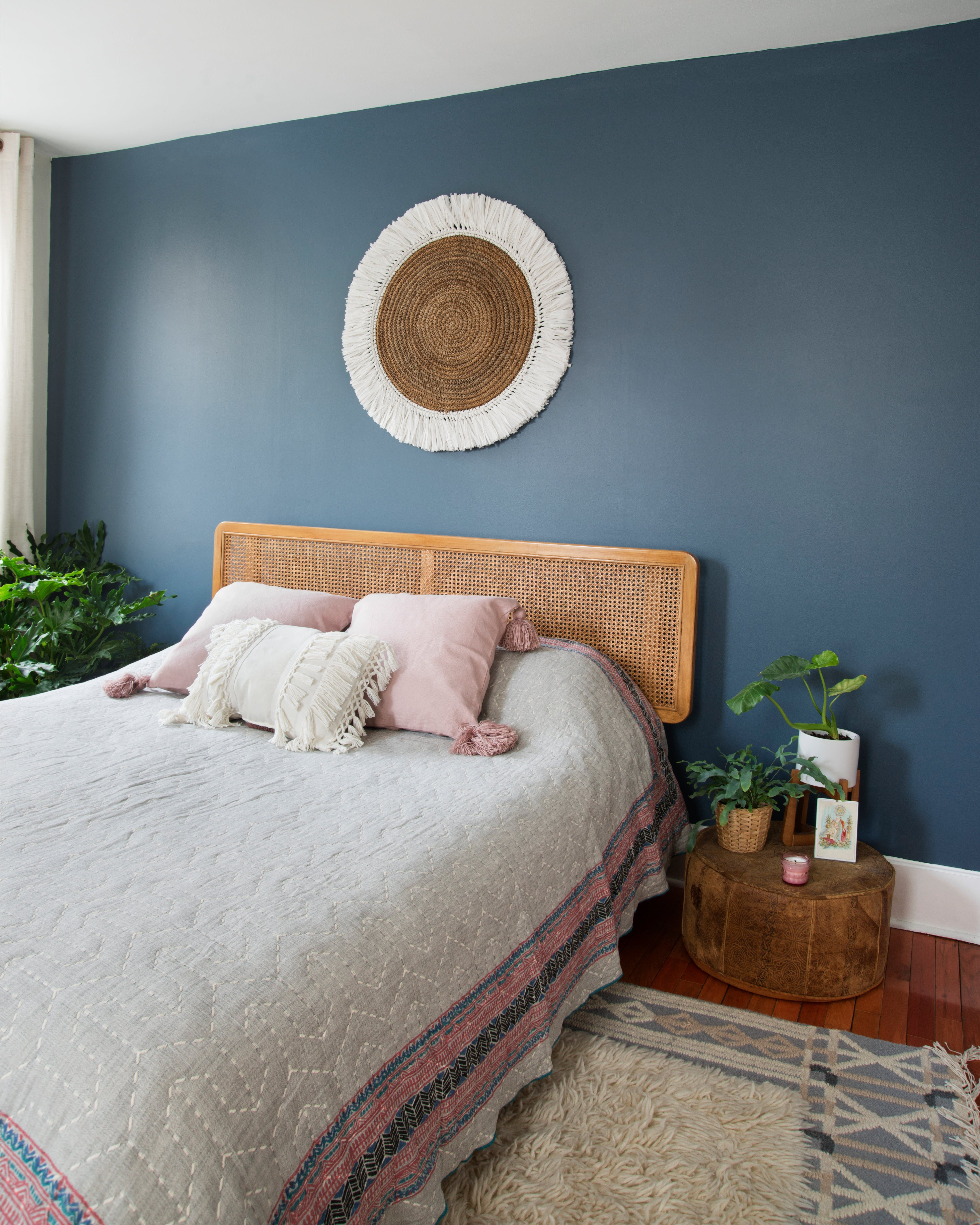 A Second Bedroom Features An Accent Wall Painted In Behrs