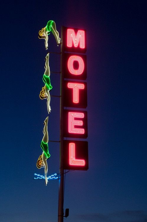 Vintage neon motel sign of divers in bathing suits on Main Street in Mesa, AZ