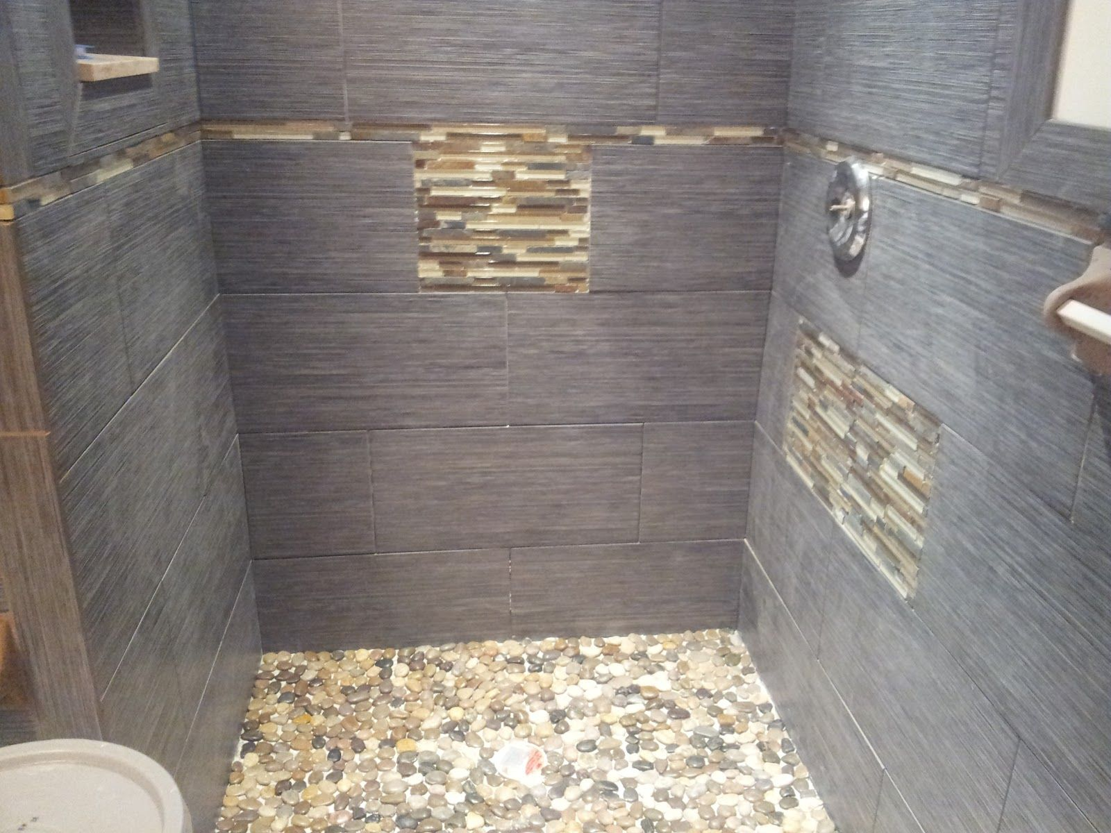 rock looking floor tile glass tile river stone and porcelain tile shower installed in