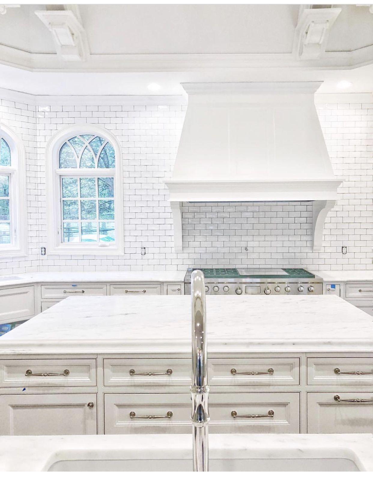 Backsplash around kitchen window  all white kitchen subway tile backsplash with slightly darker grout