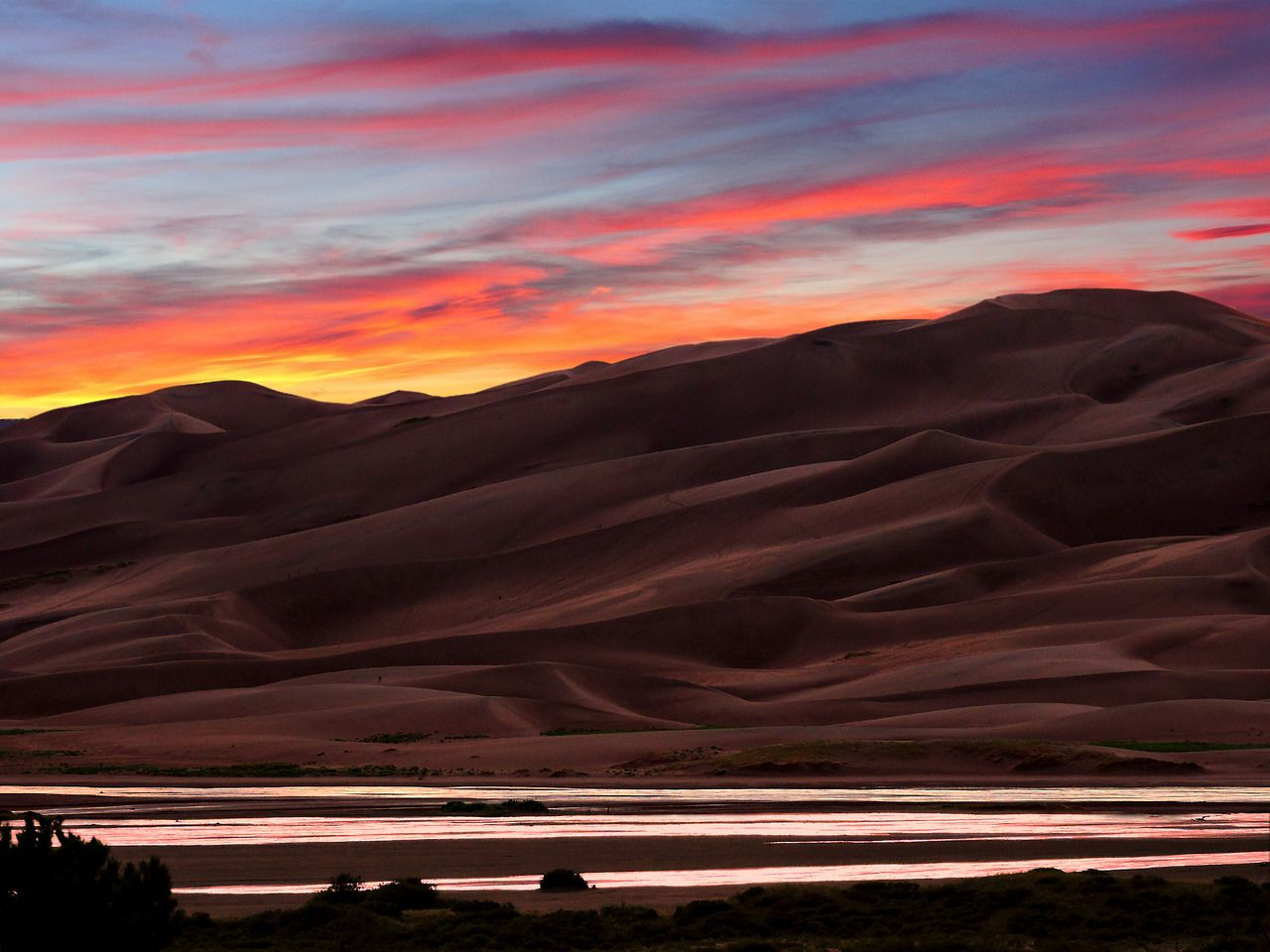 The sloping dunes and curving shadows at Great Sand Dunes