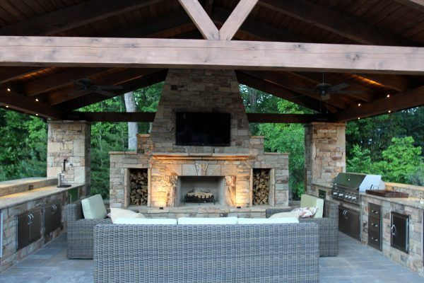 Image Of Hypnotic Outdoor Kitchen And Fireplace Omaha With Ceiling Wooden Outdoor Fans And Wall Mounted Flat Screen Tv With Bracket Also Wicker Sofa C