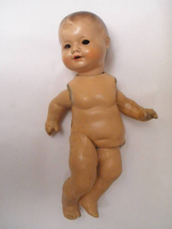 Decaying vintage baby doll with a rubber body and composition or ...