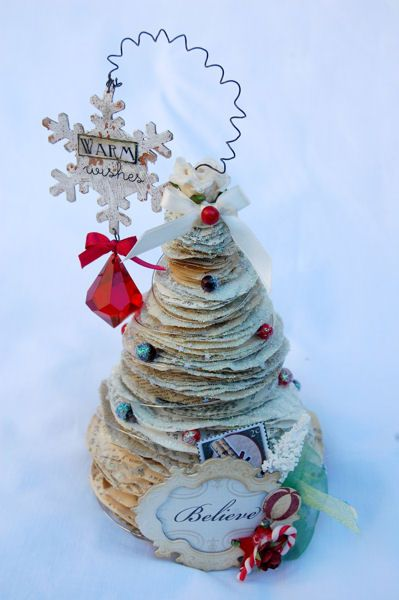 "Another great use for recycled book pages -- stacked paper Christmas tree...that is, if I can get myself to do this to any book (maybe ""Atlas shrugged"")"