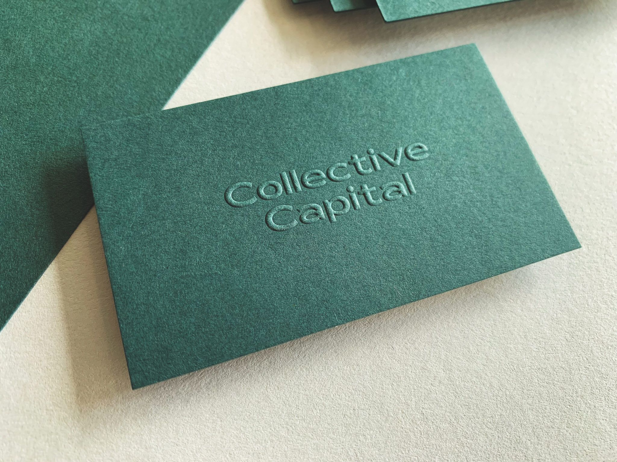 Embossed opaque white digital business cards for