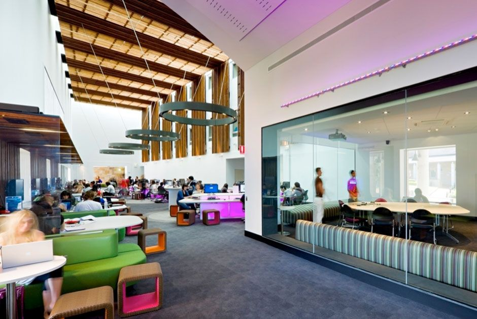 From DoDEA 21st Century Schools Interior Slideshow - An example of all glass walls for separate space; also a good example of personalized, varied workspaces throughout the commons