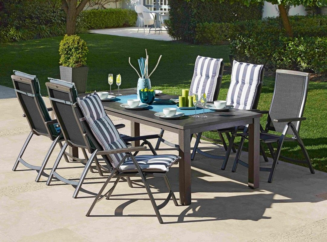 Resistant rattan effect outdoor patio dining set with round table - Outdoor Weather Resistant Patio Dining Set Featuring Scratch Resistant Table And Reclining Chairs