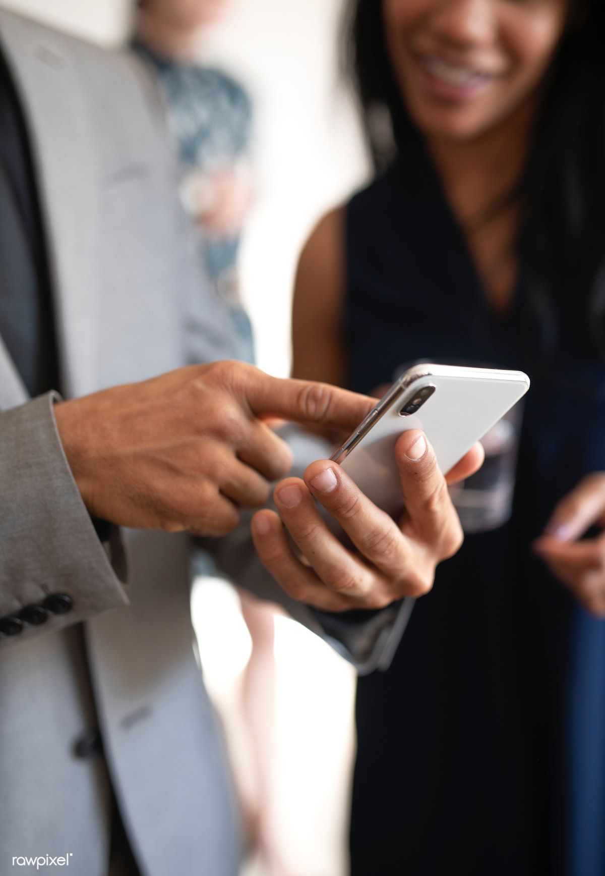 Business people using a mobile phone premium image by