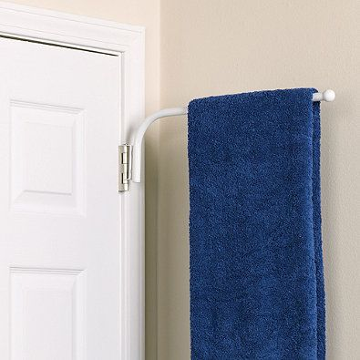 This innovative Spacemaker™ Towel Bar simply and easily ...
