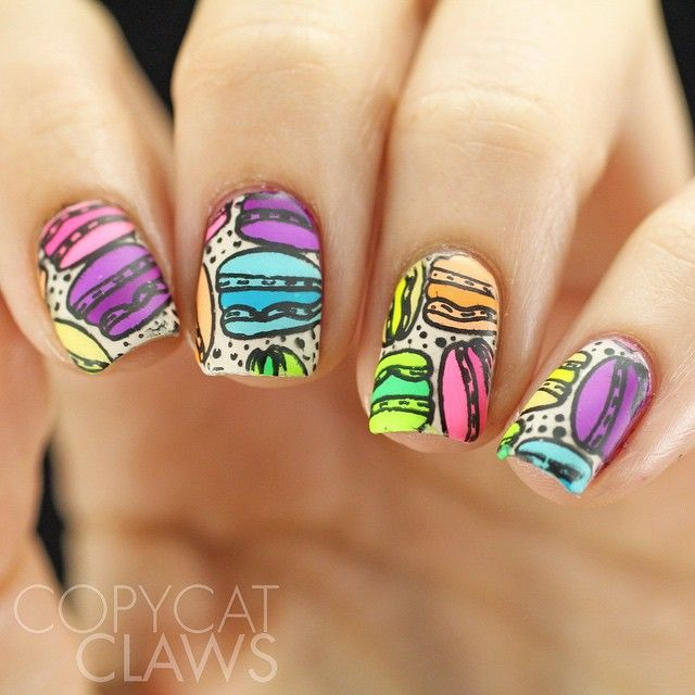 I love how these macaroons turned out with the @bundlemonster France-inspired BM-XL153 stamping plate from the Around The World collection.  I made decals with mostly the @kbshimmer Summer 2015 Neons and the @chinaglazeofficial Electric Nights collection.  And now I'm hungry...