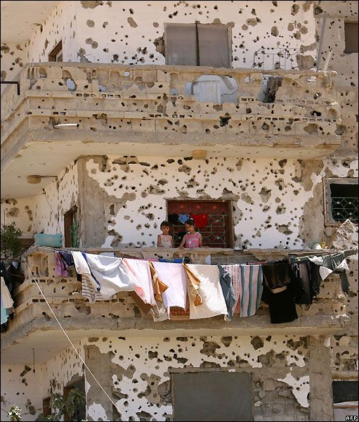 BBC News - Palestinian girls on the balcony of the ruined house in Rafa, hit during Israel's offensive against Gaza.