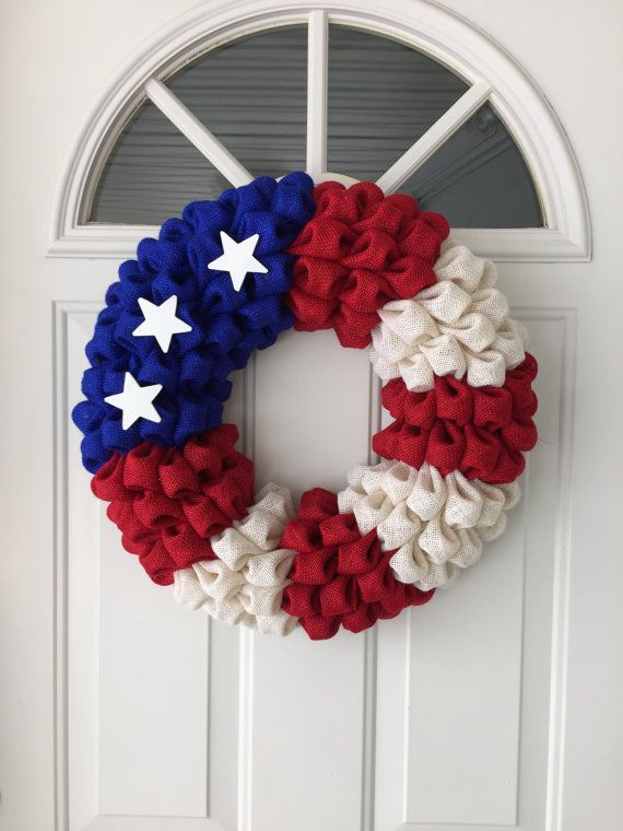 Feeling Patriotic? Get your very own 20'' Burlap Flag Wreath! Featuring Red, White, and Blue and 3 stars, this wreath is great for the 4th of July or for those who support our country!
