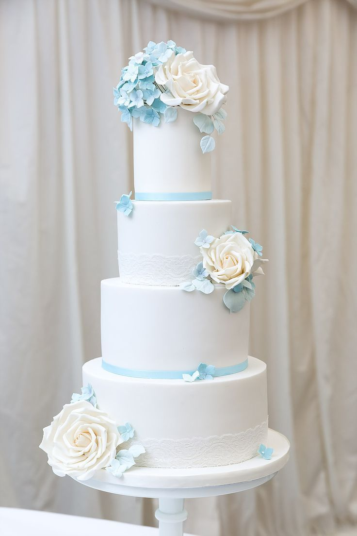 White wedding cake with light blue accents weddingcakedesigns