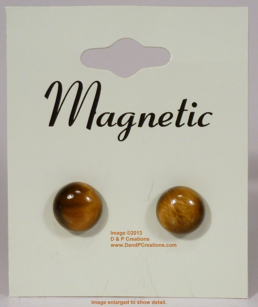 As part of our new magnetic earrings line we have this lovely pair of tigereye round cabochon earrings.  The front is a high profile tigereye cabochon stone with a polished and domed magnetic hematite back.  The polished magnetic hematite back works equally well as the front of the earring with the tigerye stone as the back.  This method allows the black to elegantly show for all fashion colors.Magnetic earrings are great for those who do not have pierced ears, both male and female. $6.95