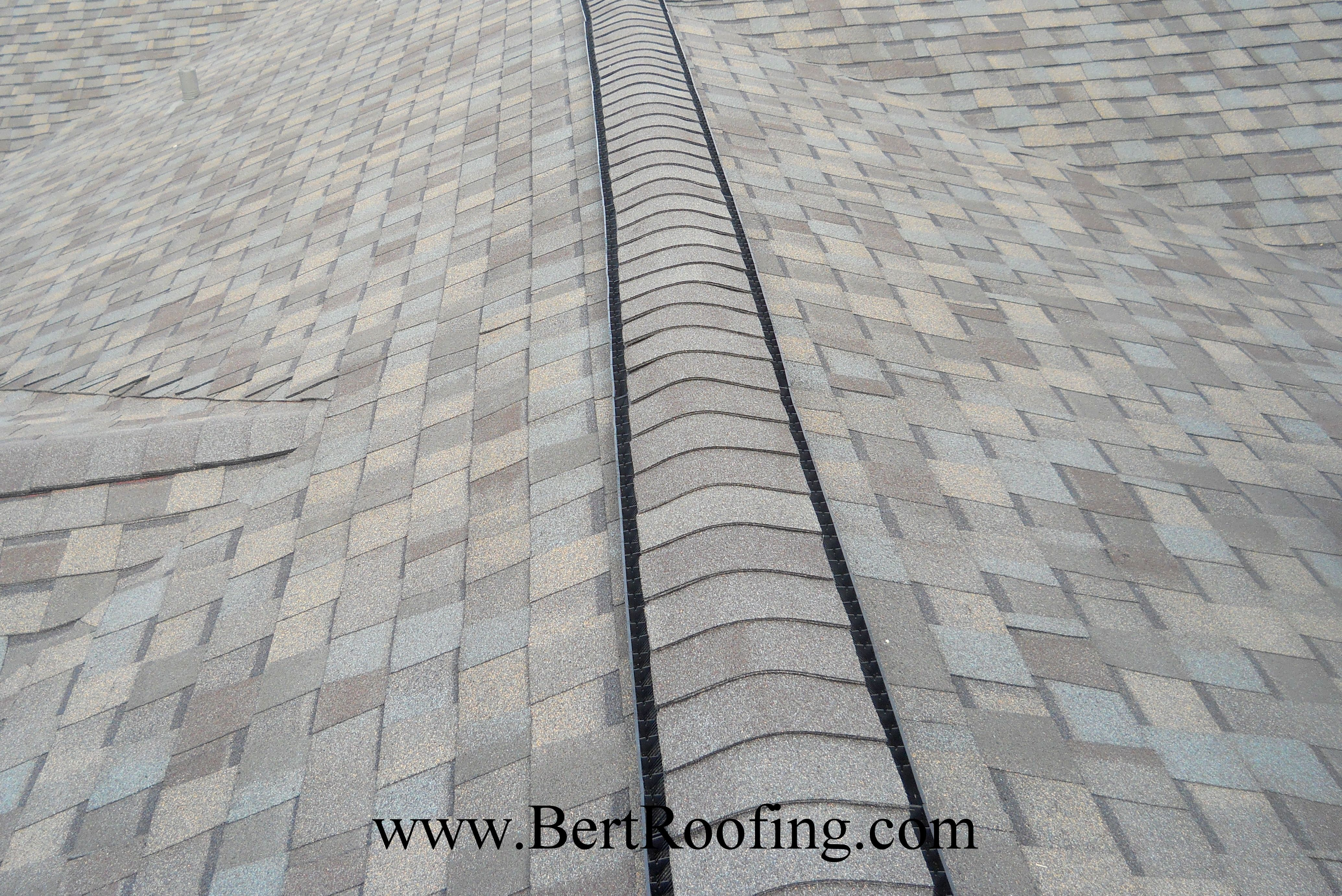 GAF Cobra 3 Ridge Vent Installed Under CertainTeed Impact Resistant,  Composition Ridge Shingles. By Bert Roofing Inc, Of Dallas On September