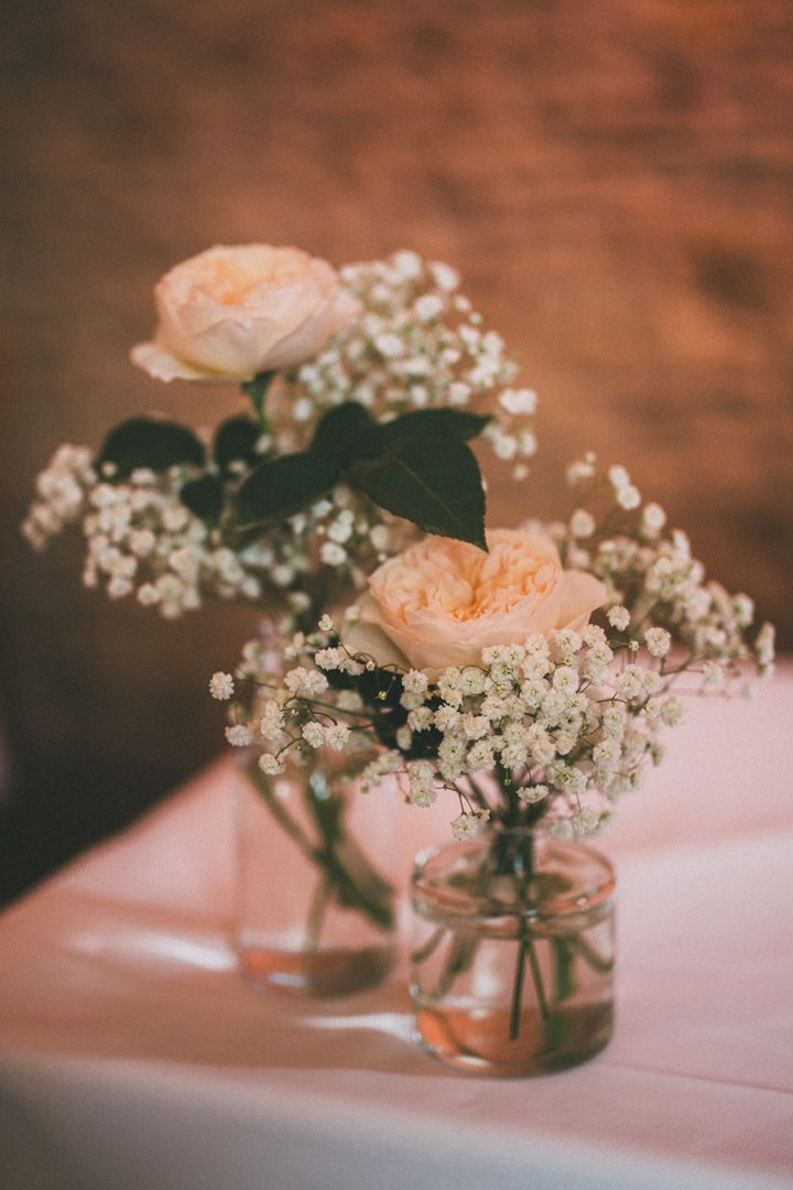 vases filled with long stem white hydrangeas and Peach Juliet Roses | fabmood.com #diywedding #peachwedding #simplecenterpieces #centerpieces