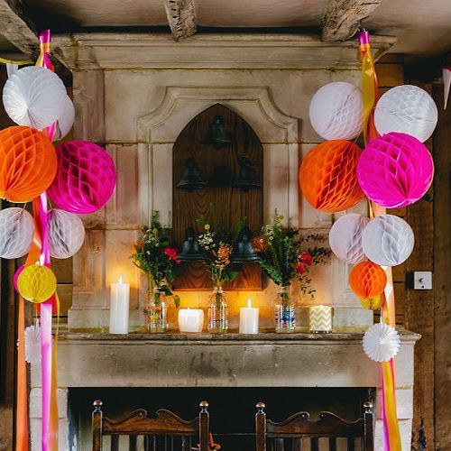 The neon colour scheme was amaze. Hot pinks, oranges and yellows all combined to pack a real punch. There were fabulous florals, striking bow ties, honeycomb balls and comic book details. Eekkk.  Link in bio  @theimagegarden  #wedding #instawedding #neon #pompoms #weddingdecor #weddinginspiration