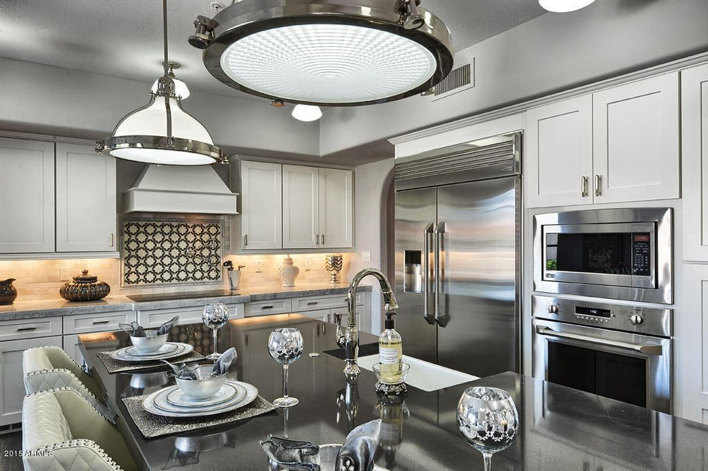 Traditional Kitchen with Shadow Gray Quartz Countertop, Shaker Recessed Panel Cabinets, Nailhead Fabric Stool