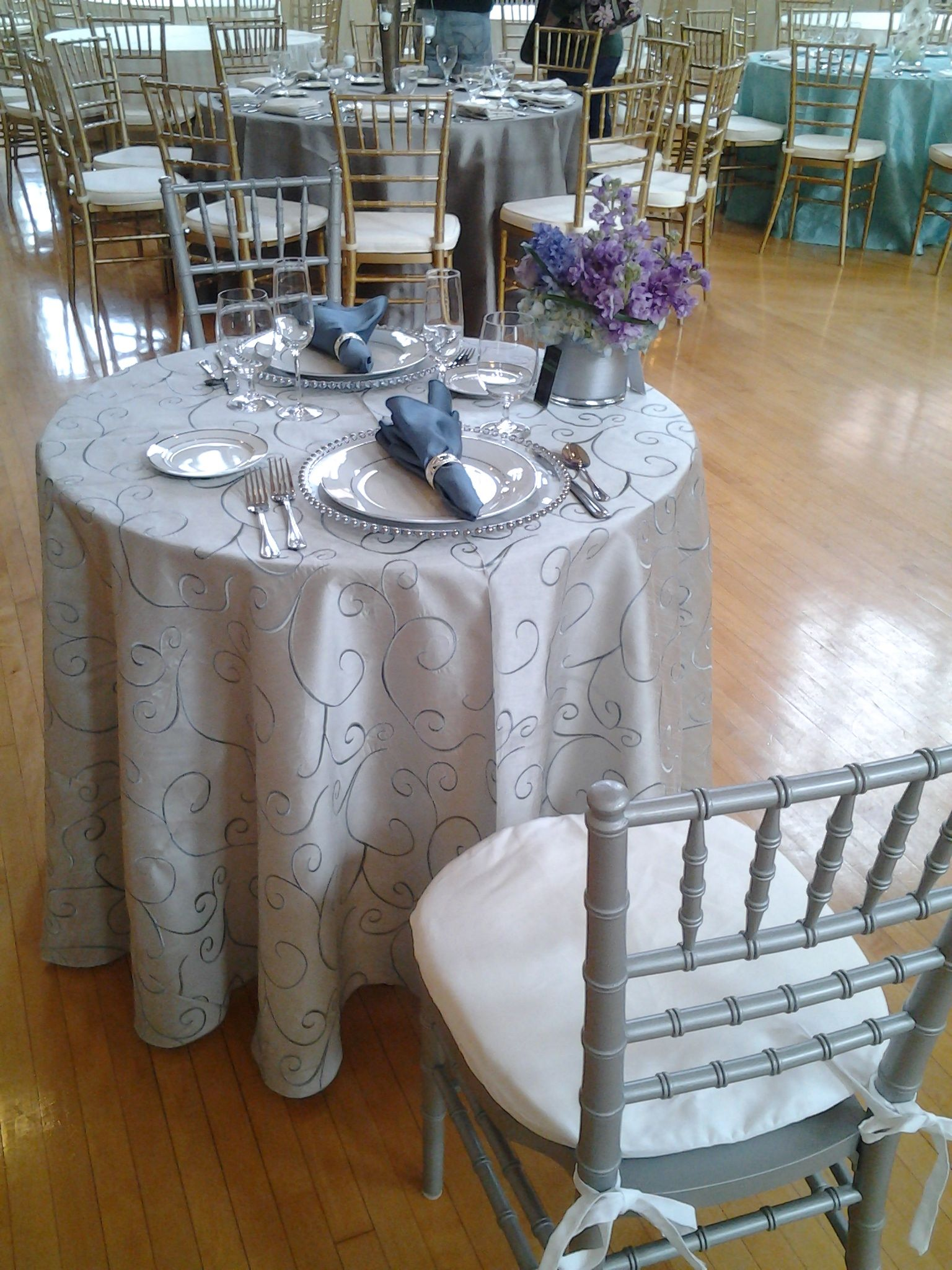 PS Event Rental s Silver Swirl Dupioni Table Linen with the Glass
