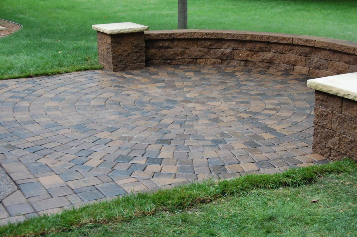 Patio designs among retaining walls combined with flooring for Landscape blocks