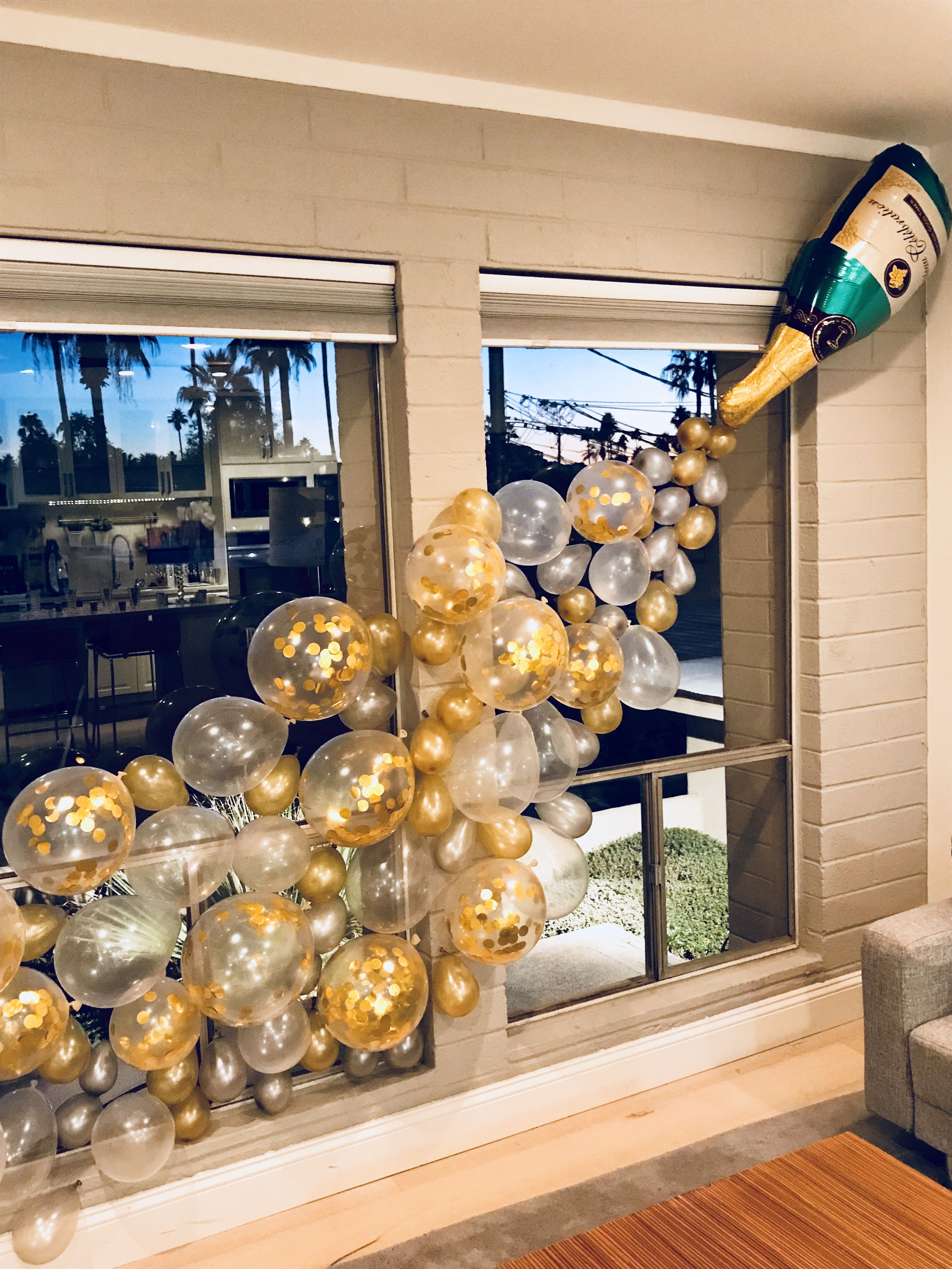 Champagne bottle balloon wall for bachelorette party. This