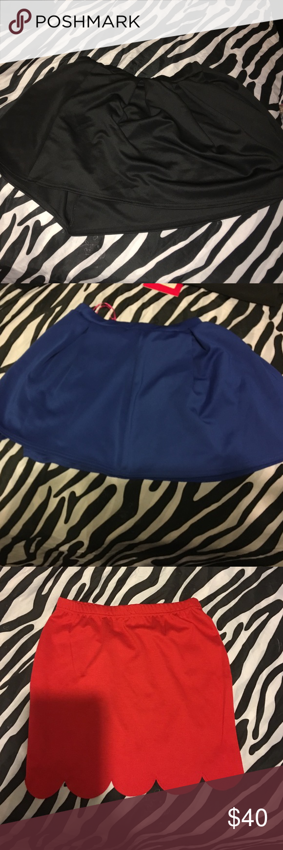 *BUNDLE DEAL*. 4 skirts 2 skater skirts (1black , 1blue) 2 mini skirts (1black, 1red) Skirts