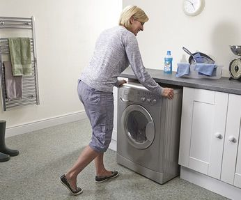 A Washing Machine Sliding Back Into Position With The Aid Of A Magiglide Magiglide Appliance Move Moving A Washing Machine How To Make Light Washing Machine