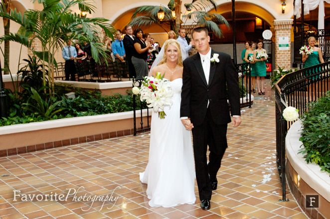 © Favorite Photography | Happy Couple Photo | Wedding Photos | Walking down the Aisle Wedding Photo | Embassy Suites Wedding | Jacksonville Embassy Suites Wedding | Indoor Wedding Location