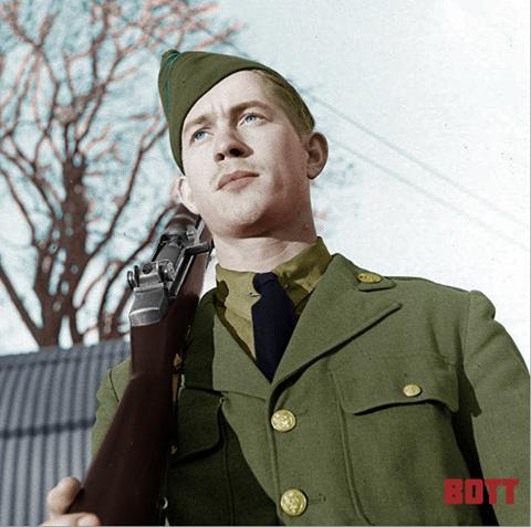 An infantryman in his Class A service uniform and M1 Garand. Circa Winter 1942.