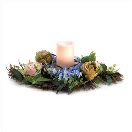 Spring Floral Fabric Flower Wreath Tabletop Centerpiece by Furniture Creations. $10.37. Heartwarming and affectionate gift item for friends.. Beautifully presented faux candle surrounded by a fabric floral wreath.. Exquisite décor item for spring theme festivities or weddings.. Perfect for display on any mantel, shelf or tabletop.. Flameless LED candle with a floral fragrance.. Colorful fabric flower wreath and candle create a perfect spring centerpiece. Candl...