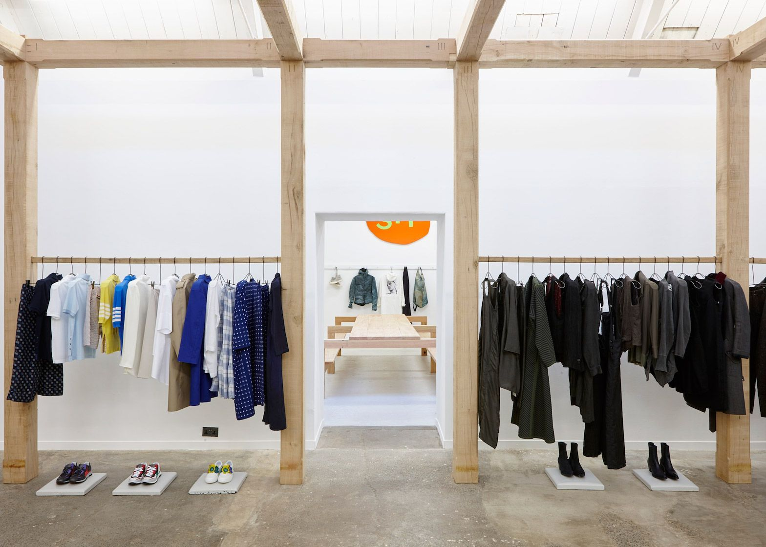 garments hang from a handmade oak structure inside fashion boutique hostem 39 s pop up store. Black Bedroom Furniture Sets. Home Design Ideas